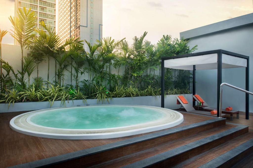 The swimming pool at or near Radisson Suites Bangkok Sukhumvit