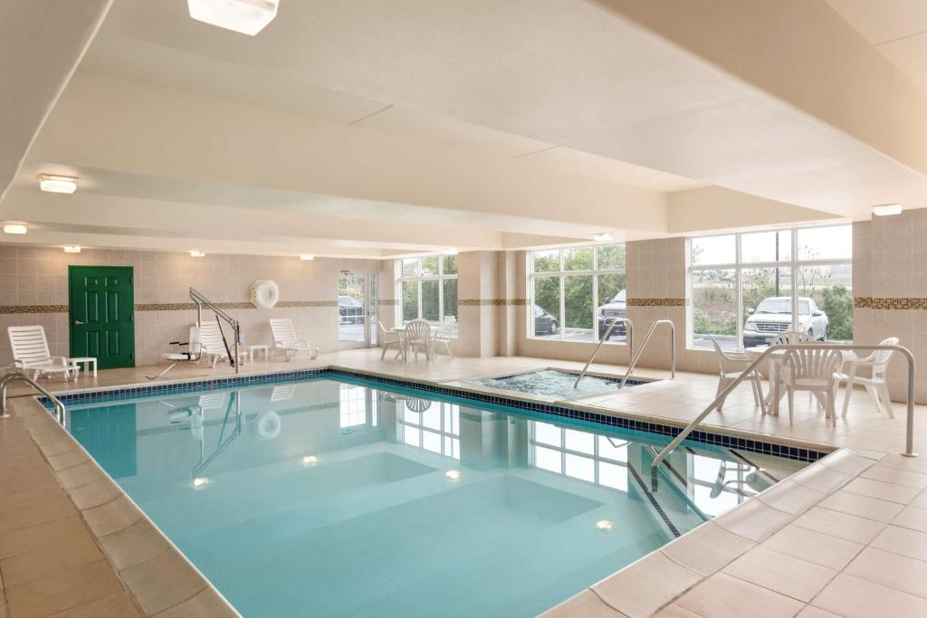 The swimming pool at or near Country Inn & Suites by Radisson, Harrisburg at Union Deposit Road, PA
