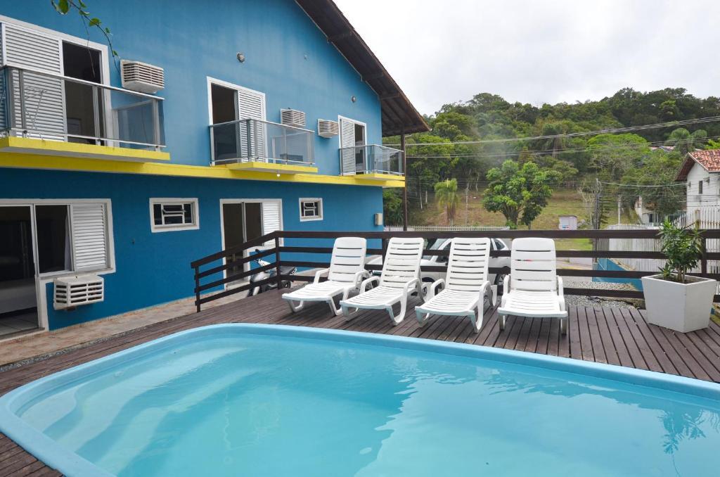 The swimming pool at or near Pousada Paraíso