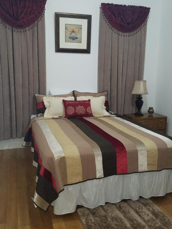 A bed or beds in a room at The Moses Suites