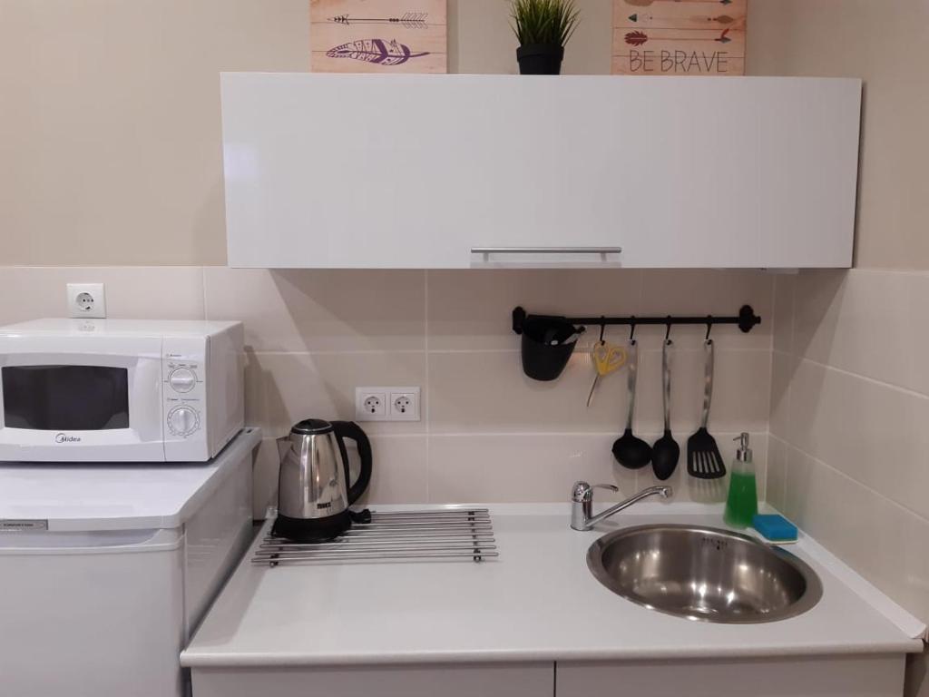 Кухня или мини-кухня в Aparthotel Podkova