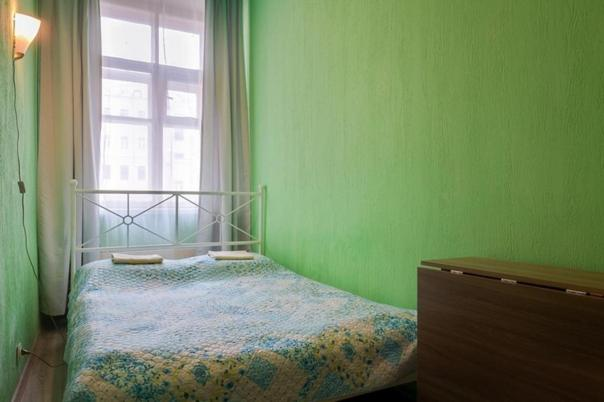 A bed or beds in a room at Яркий Дом