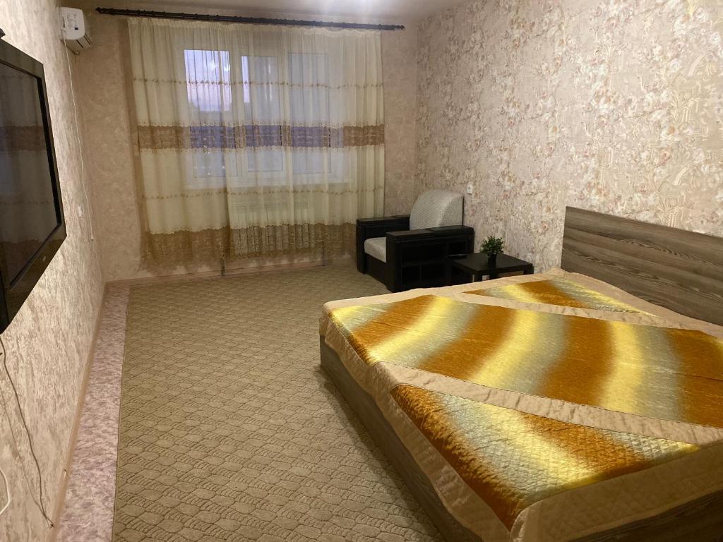 Кровать или кровати в номере 2-х комнатная квартира