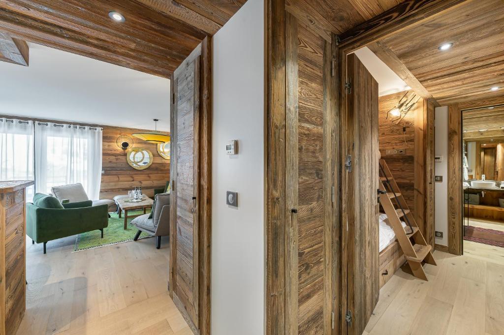 Appartement vue piste - 6 pax - Salon avec Cheminée T201