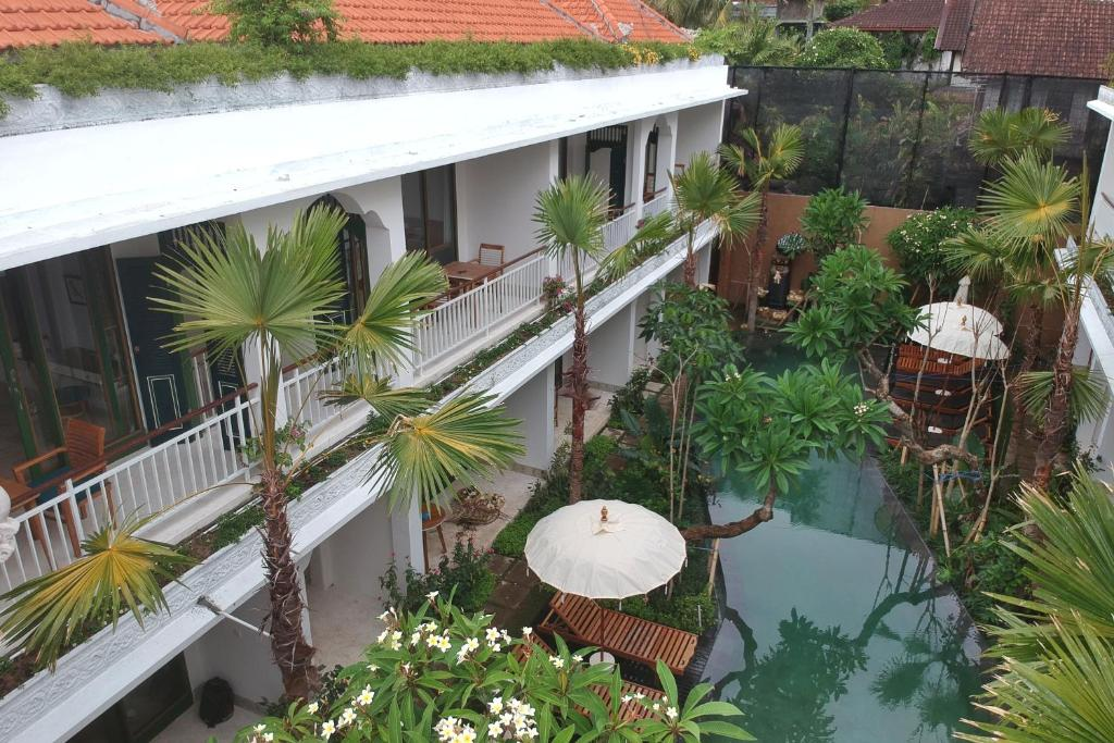 A view of the pool at Sabana Ubud or nearby