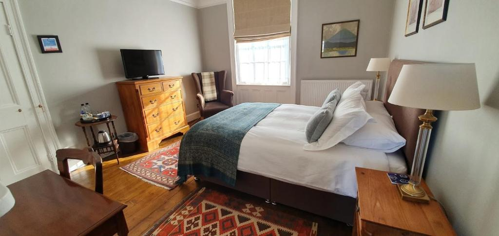 A bed or beds in a room at The Lions