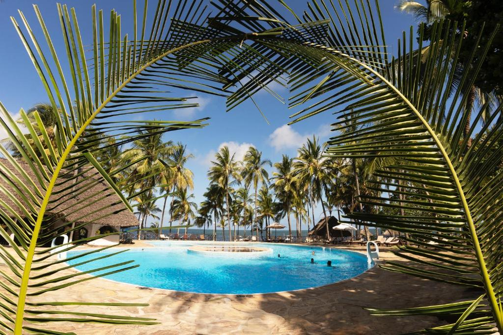 The swimming pool at or close to Sandies Tropical Village