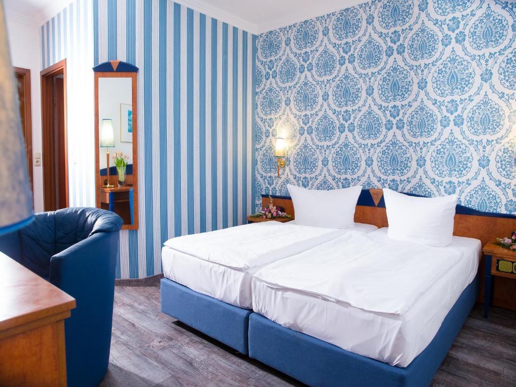 Ein Bett oder Betten in einem Zimmer der Unterkunft Pension Weinberg Güstrow