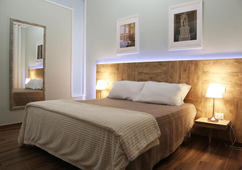 A bed or beds in a room at Residenza La Reggia