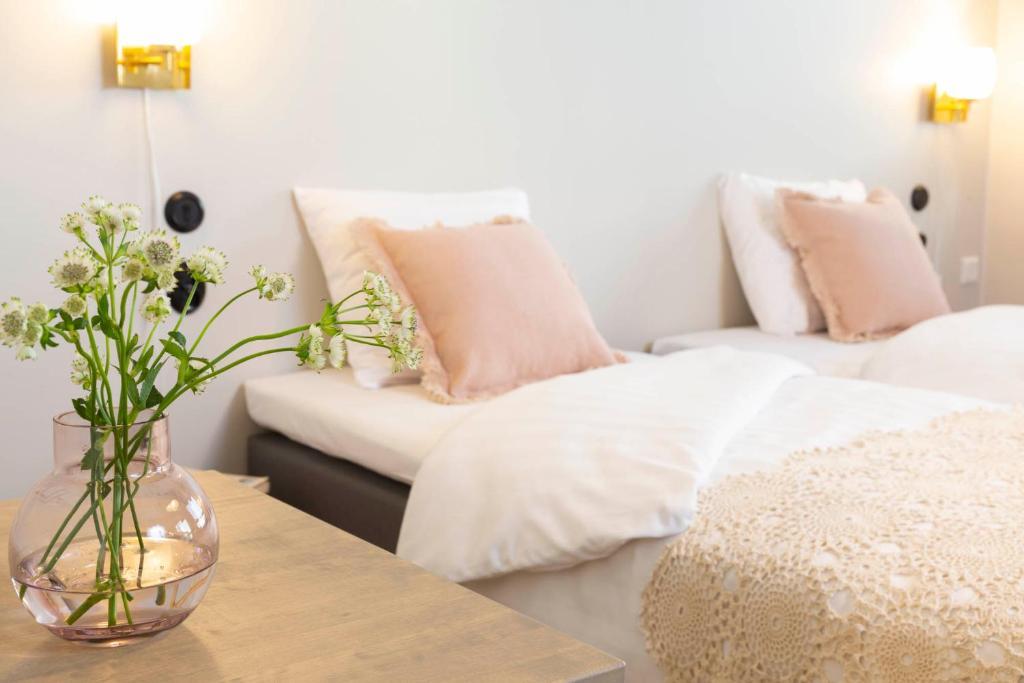 Ein Bett oder Betten in einem Zimmer der Unterkunft Lietsu Boutique Aparthotel - Huoneistohotelli Lietsu