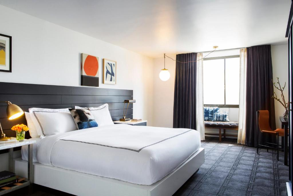 A bed or beds in a room at Kimpton Buchanan Hotel