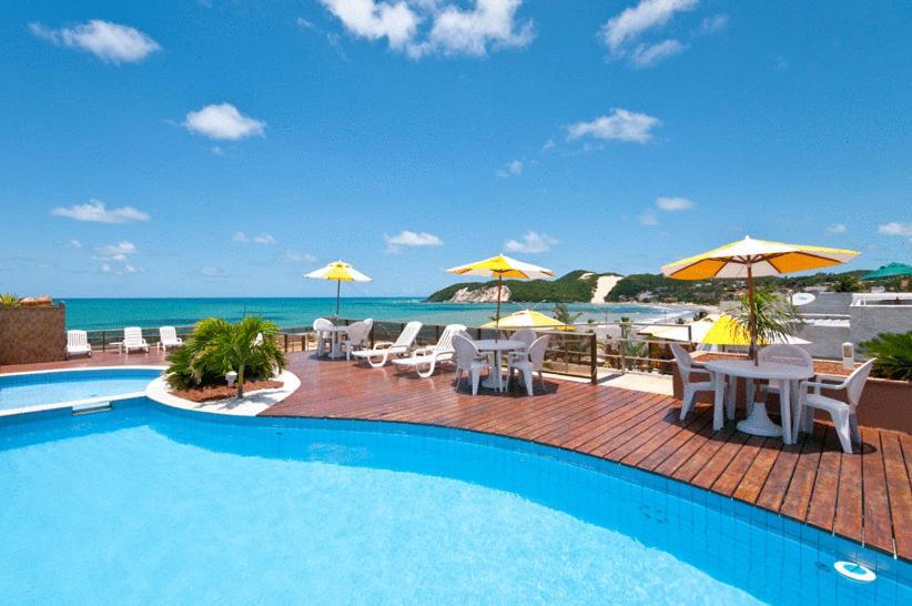 A piscina localizada em Mirador Praia Hotel ou nos arredores