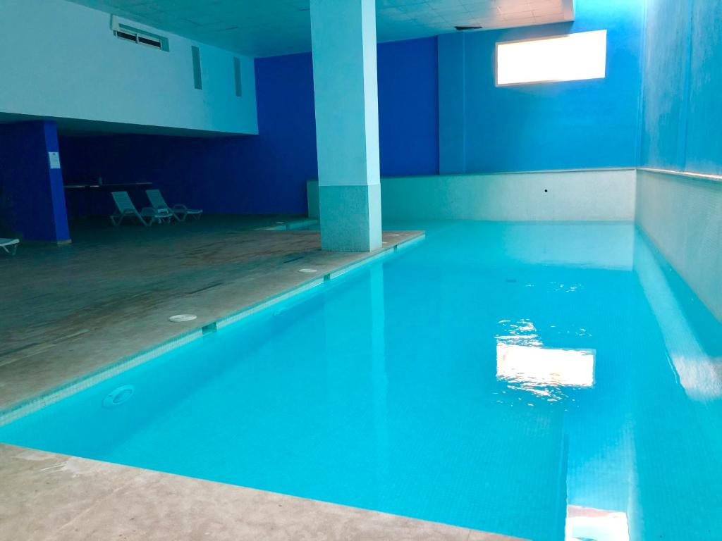 The swimming pool at or near Sunshine Apartment Marrakech