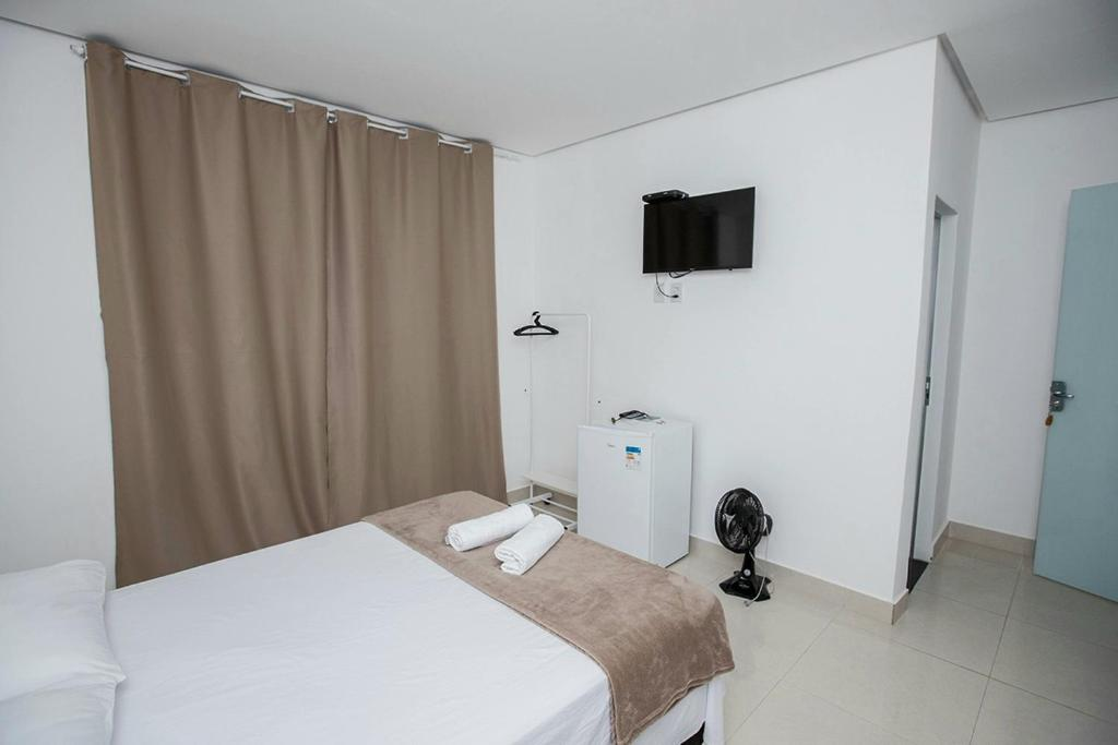 A bed or beds in a room at Pousada Jeitim Mineiro