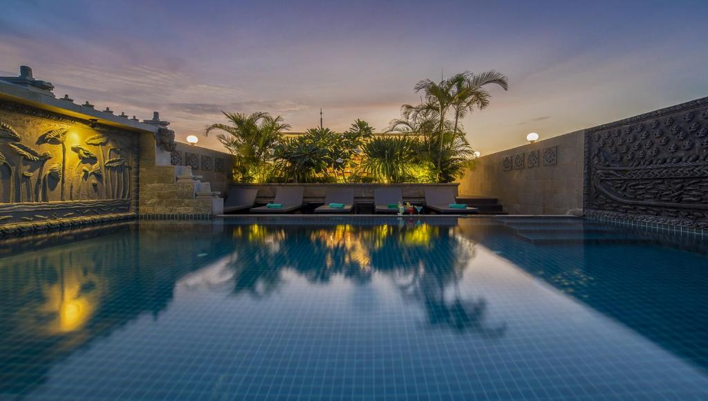 The swimming pool at or near The Grand Cyclo Boutique Suite & Spa