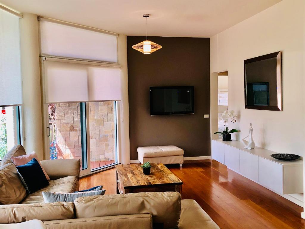 A television and/or entertainment center at Exclusive Anglesea River Beach Apartment