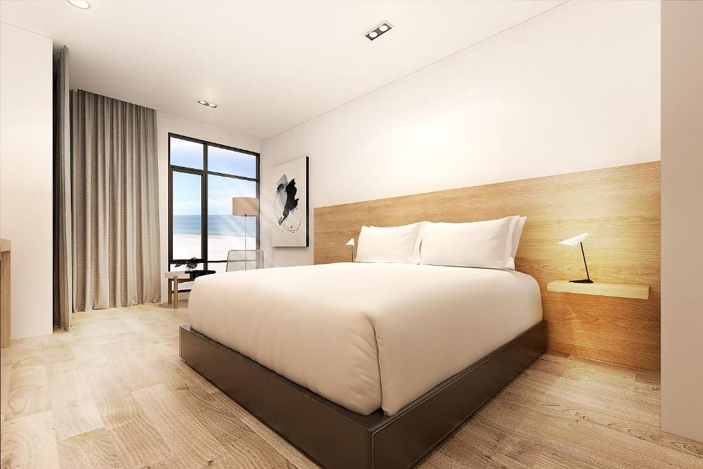 A bed or beds in a room at Chill Suites Langkawi