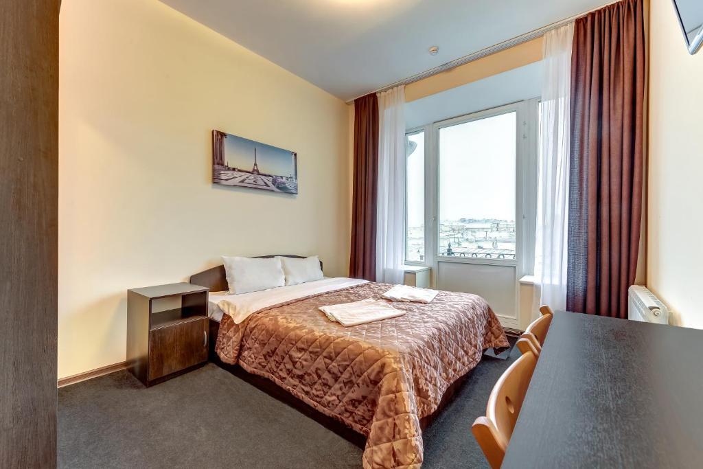 Кровать или кровати в номере SuperHostel на Невском Проспекте 95