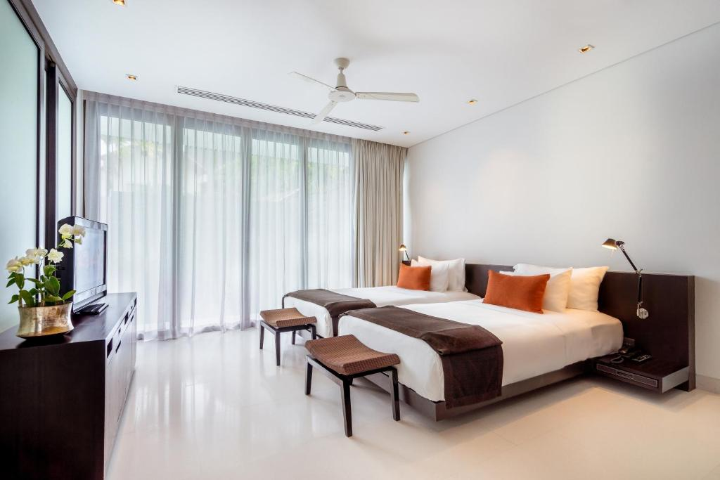 A bed or beds in a room at Twinpalms Phuket