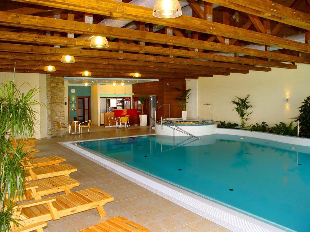 The swimming pool at or near Wellness Hotel Happy Star