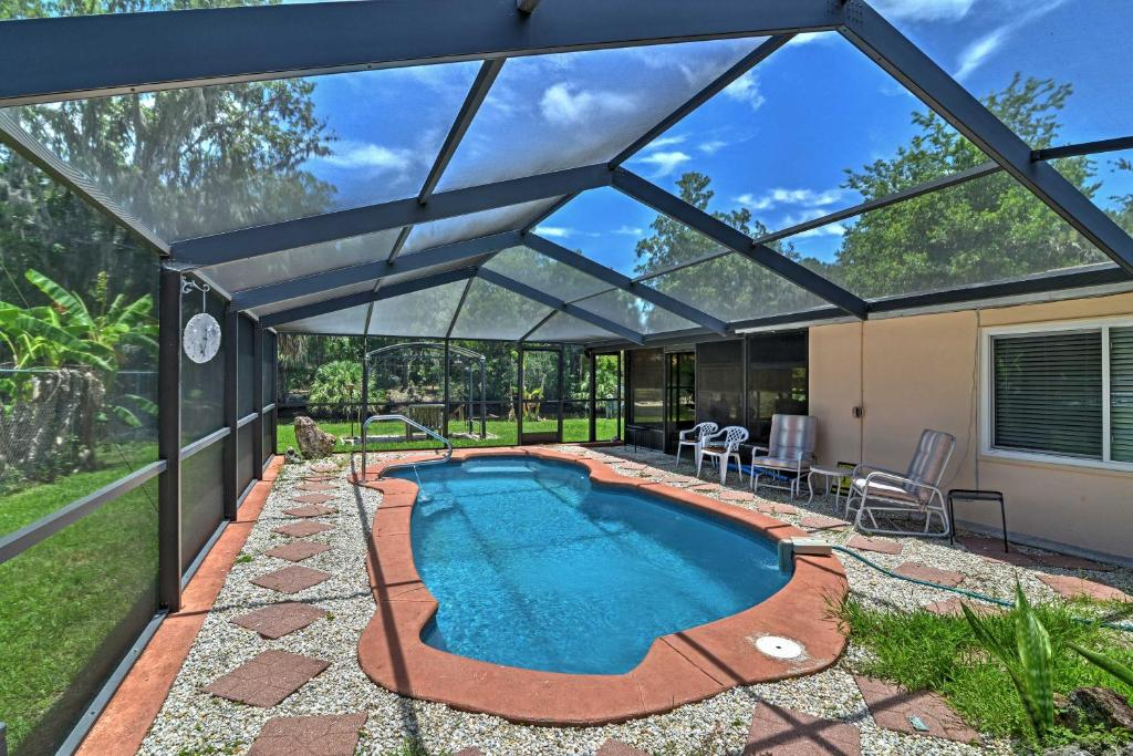 The swimming pool at or close to Waterfront Crystal River House with Screened-in Pool!