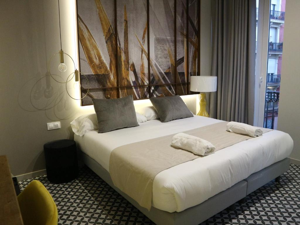A bed or beds in a room at YOU & CO. Quart Boutique