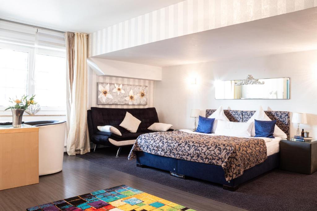 Ein Bett oder Betten in einem Zimmer der Unterkunft Apartments am Prinzenplatz - Superior