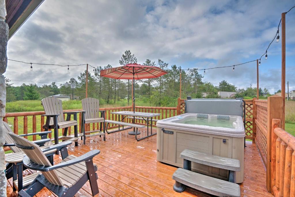 Rustic Benezette Cabin with Porch, Hot Tub & Fire Pit