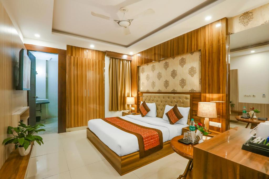 A bed or beds in a room at Hotel Almati Inn at Delhi Airport