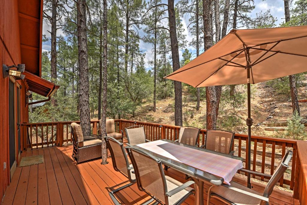 A restaurant or other place to eat at Prescott Cabin with Beautiful Forest Views and Deck!