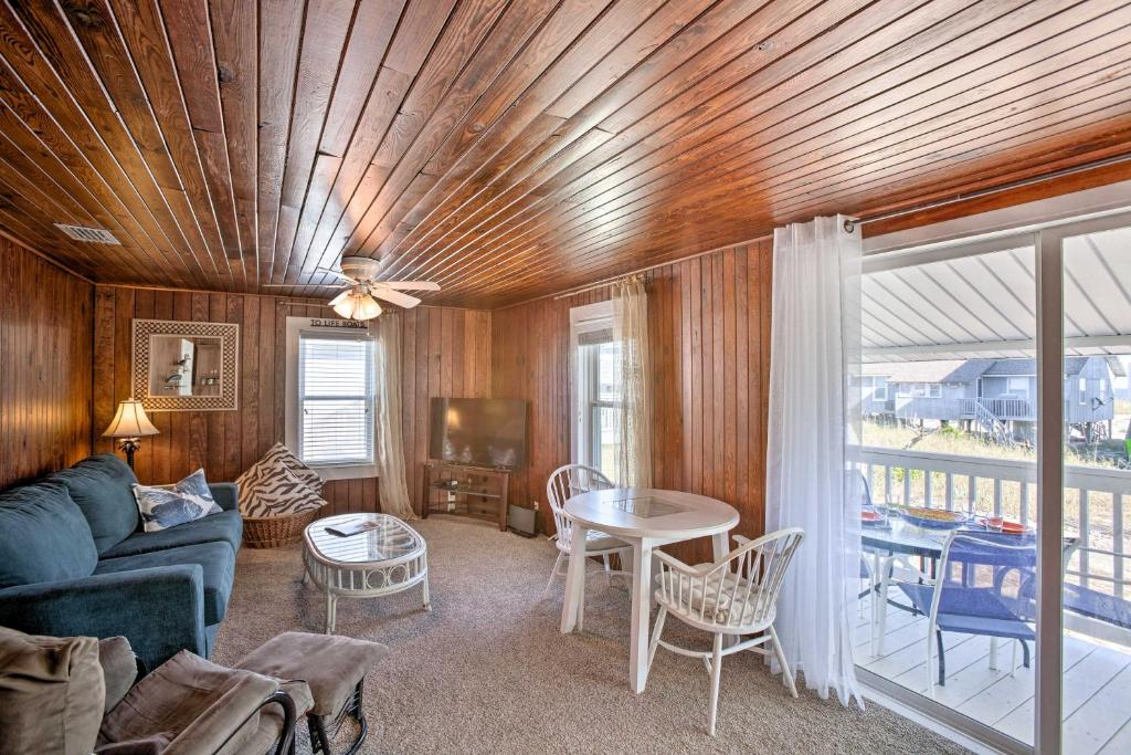 A seating area at Old School Fernandina Beach Duplex with Ocean View!