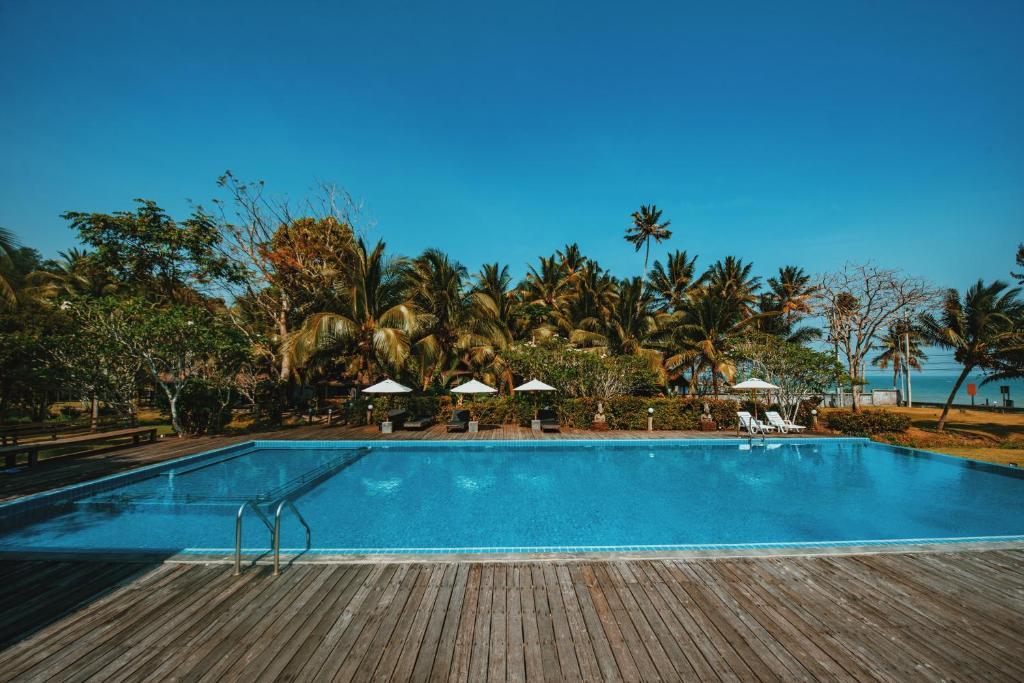 The swimming pool at or near Nana Beach Hotel & Resort