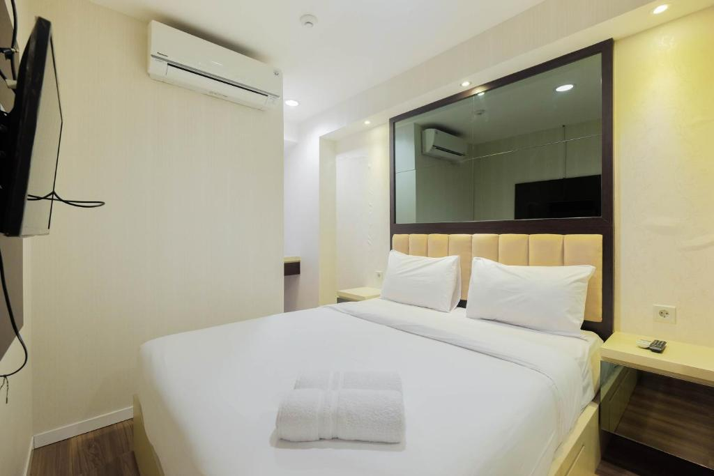 Luxurious and Comfy 2BR Cinere Bellevue Suites Apartment By Travelio