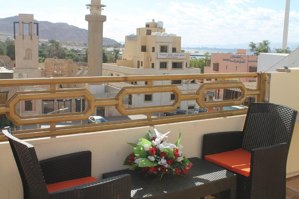 A balcony or terrace at Relax House Hostel