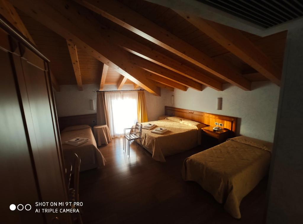 A bed or beds in a room at Azzano Holidays B&B