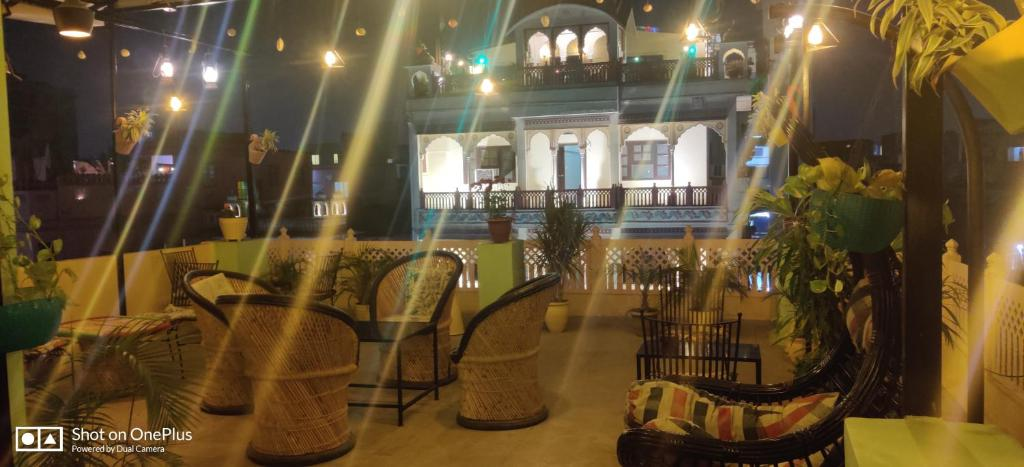 A restaurant or other place to eat at Madhav Guest House