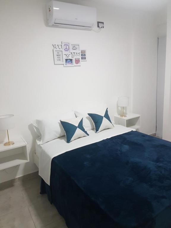 A bed or beds in a room at Miguel Angel 5673 - A 5 minutos del Aeropuerto El Palomar
