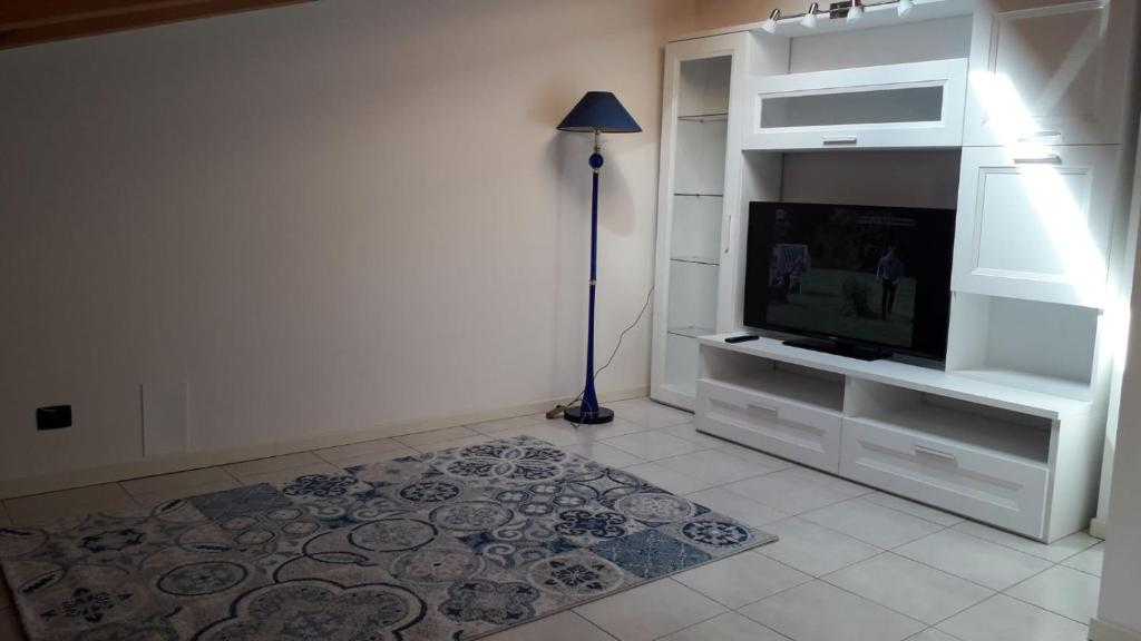 A television and/or entertainment center at Delle Rose apartment