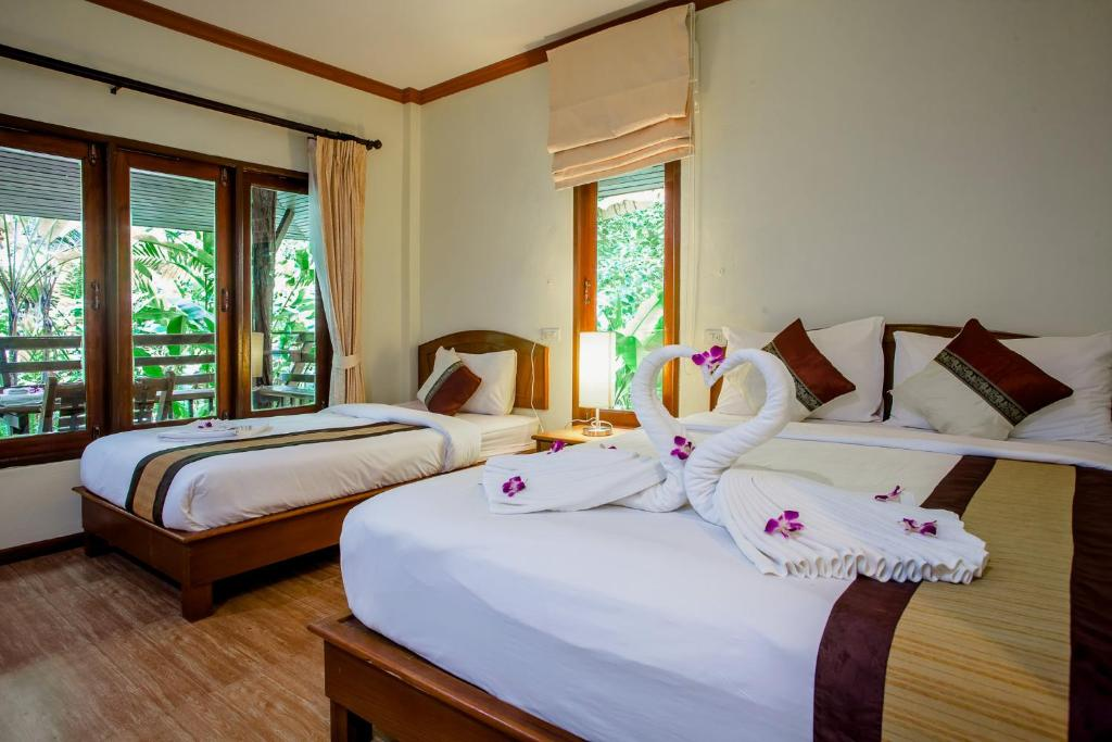 A bed or beds in a room at Ao Nang Cliff View Resort