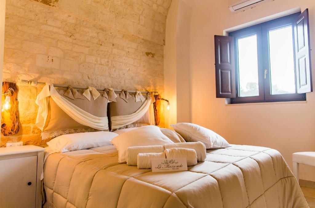 Letto o letti in una camera di Relais La Masseriola