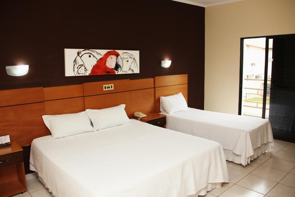 Кровать или кровати в номере Real Palace Hotel