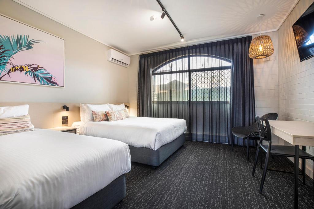 A bed or beds in a room at Nightcap at Springwood Hotel