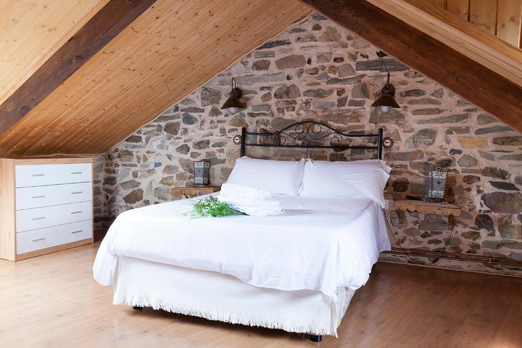 Cama o camas de una habitación en La Rosa Del Agua