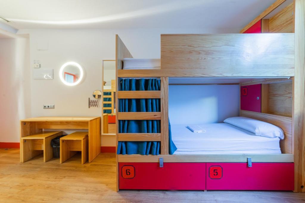 A bunk bed or bunk beds in a room at Ok Hostel Madrid