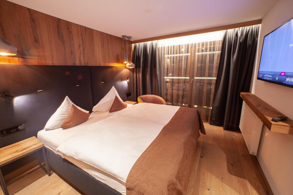 Ein Bett oder Betten in einem Zimmer der Unterkunft Gourmethotel Yscla