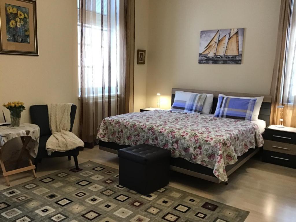Postel nebo postele na pokoji v ubytování ML Apartment