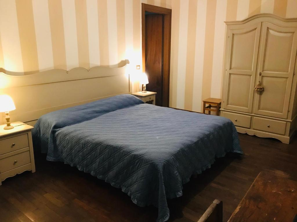 A bed or beds in a room at B&B Al Ponte