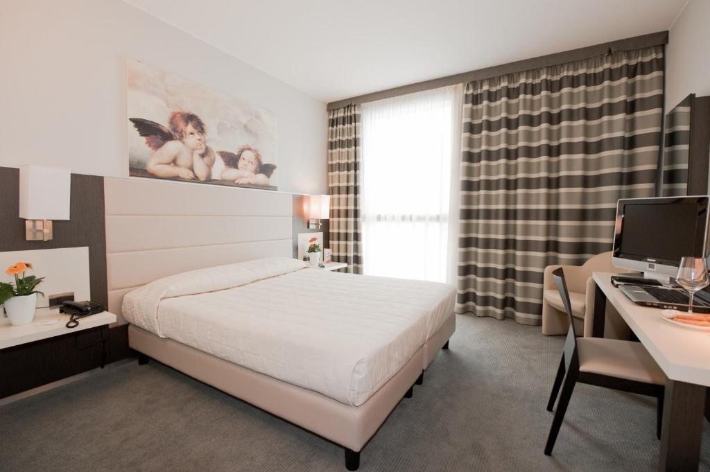 Letto o letti in una camera di Hotel Rivarolo