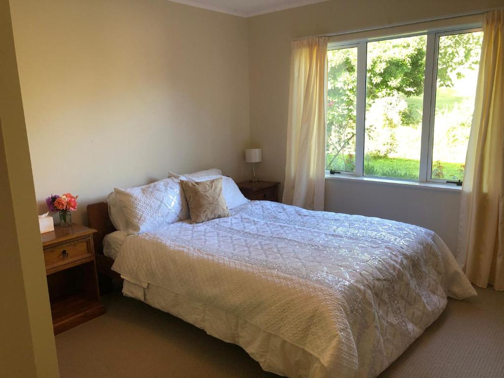 A bed or beds in a room at Rotorua Farm Stay