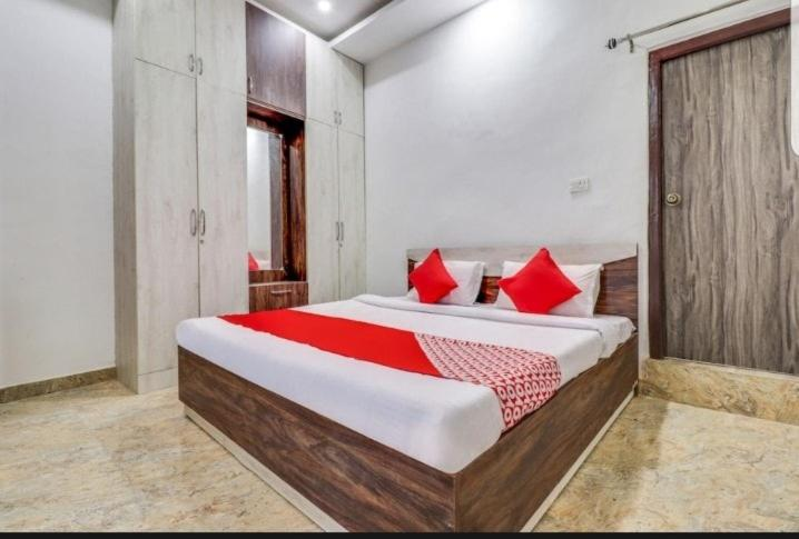 A bed or beds in a room at Shiv Shanti Lawn